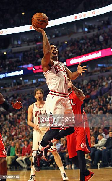 Derrick Rose of the Chicago Bulls goes up for a shot against the Atlanta Hawks at the United Center on April 15 2015 in Chicago Illinois NOTE TO USER...