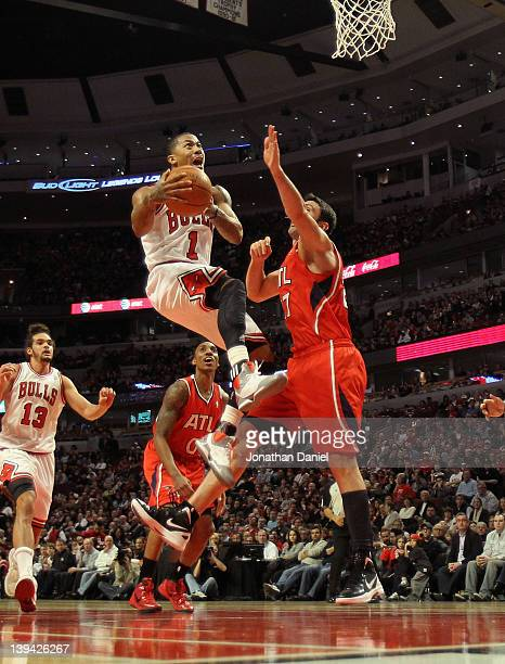 Derrick Rose of the Chicago Bulls goes up for a shot against Zaza Pachulia of the Atlanta Hawks on his way to a gamehigh 23 points at the United...