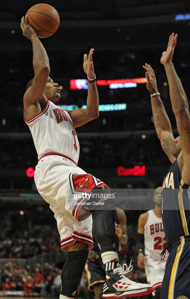 <a gi-track='captionPersonalityLinkClicked' href=/galleries/search?phrase=Derrick+Rose&family=editorial&specificpeople=4212732 ng-click='$event.stopPropagation()'>Derrick Rose</a> #1 of the Chicago Bulls goes up for a shot in front of <a gi-track='captionPersonalityLinkClicked' href=/galleries/search?phrase=Dahntay+Jones&family=editorial&specificpeople=202206 ng-click='$event.stopPropagation()'>Dahntay Jones</a> #1 of the Indiana Pacers at the United Center on December 20, 2011 in Chicago, Illinois. The Bulls defeated the Pacers 93-85.
