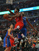 Derrick Rose of the Chicago Bulls goes up for a shot past Kevin Durant of the Oklahoma City Thunder at the United Center on November 5 2015 in...