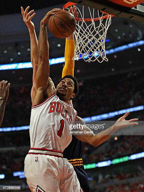 Derrick Rose of the Chicago Bulls grabs a rebound in front of Timofey Mozgov of the Cleveland Cavaliers in Game Four of the Eastern Conference...