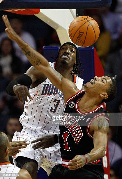 Derrick Rose of the Chicago Bulls has his shot blocked by Gerald Wallace of the Charlotte Bobcats during their game at Time Warner Cable Arena on...