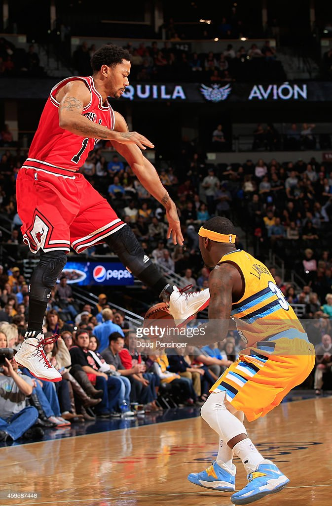 <a gi-track='captionPersonalityLinkClicked' href=/galleries/search?phrase=Derrick+Rose&family=editorial&specificpeople=4212732 ng-click='$event.stopPropagation()'>Derrick Rose</a> #1 of the Chicago Bulls has the ball stolen by <a gi-track='captionPersonalityLinkClicked' href=/galleries/search?phrase=Ty+Lawson&family=editorial&specificpeople=4024882 ng-click='$event.stopPropagation()'>Ty Lawson</a> #3 of the Denver Nuggets at Pepsi Center on November 25, 2014 in Denver, Colorado.