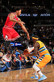 Derrick Rose of the Chicago Bulls has the ball stolen by Ty Lawson of the Denver Nuggets at Pepsi Center on November 25 2014 in Denver Colorado NOTE...