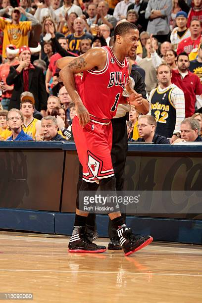 Derrick Rose of the Chicago Bulls heads to the locker room after turning his ankle in the first quarter against the Indiana Pacers in Game Four of...