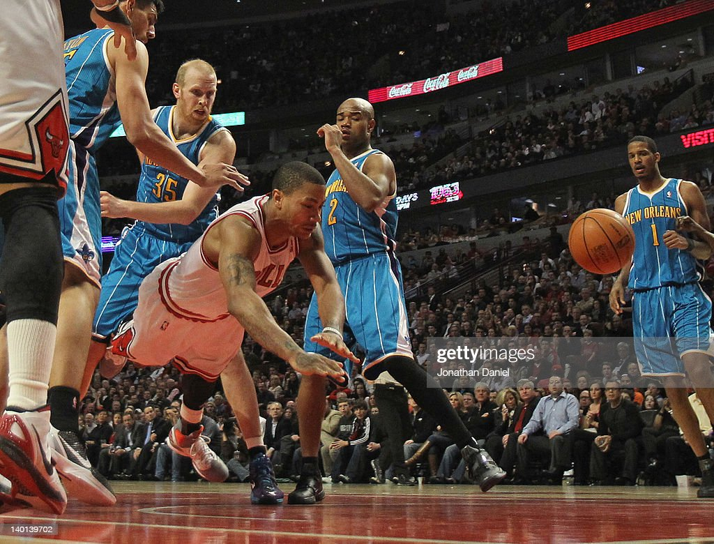 Derrick Rose #1 of the Chicago Bulls hits the floor after being fouled by Chris Kaman #35 of the New Orleans Hornets at the United Center on February 28, 2012 in Chicago, Illinois. The Bulls defeated the Hornets 99-95.