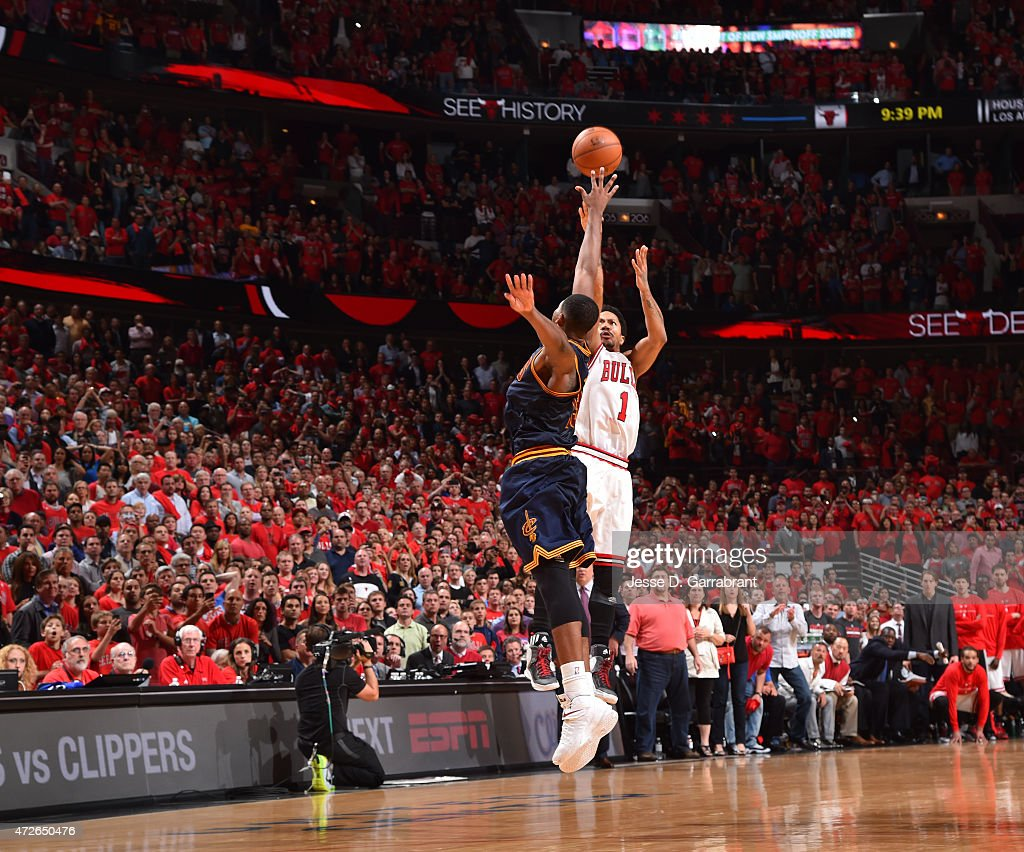 Derrick Rose #1 of the Chicago Bulls hits the game winning three pointer with three seconds left in the game against the Cleveland Cavaliers at the United Center During Game Two of the Eastern Conference Semifinals during the 2015 NBA Playoffs on May 8, 2015 in Chicago,Illinois