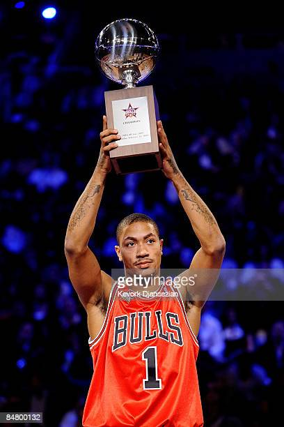 Derrick Rose of the Chicago Bulls holds up the trophy after winning the Play Station Skills Challenge on AllStar Saturday Night part of 2009 NBA...