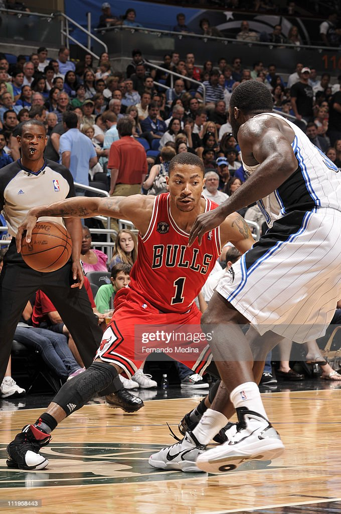 <a gi-track='captionPersonalityLinkClicked' href=/galleries/search?phrase=Derrick+Rose&family=editorial&specificpeople=4212732 ng-click='$event.stopPropagation()'>Derrick Rose</a> #1 of the Chicago Bulls in action against <a gi-track='captionPersonalityLinkClicked' href=/galleries/search?phrase=Brandon+Bass&family=editorial&specificpeople=233806 ng-click='$event.stopPropagation()'>Brandon Bass</a> #30 of the Orlando Magic on April 10, 2011 at the Amway Center in Orlando, Florida.