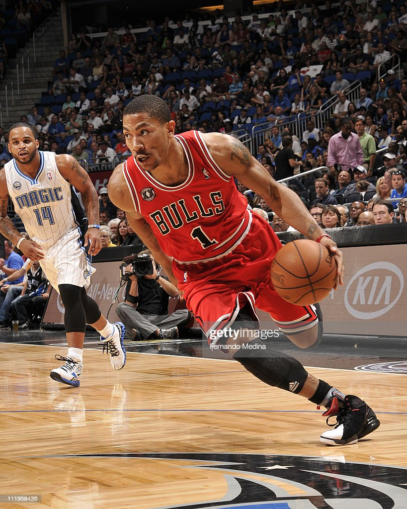 <a gi-track='captionPersonalityLinkClicked' href=/galleries/search?phrase=Derrick+Rose&family=editorial&specificpeople=4212732 ng-click='$event.stopPropagation()'>Derrick Rose</a> #1 of the Chicago Bulls in action against the Orlando Magic on April 10, 2011 at the Amway Center in Orlando, Florida.