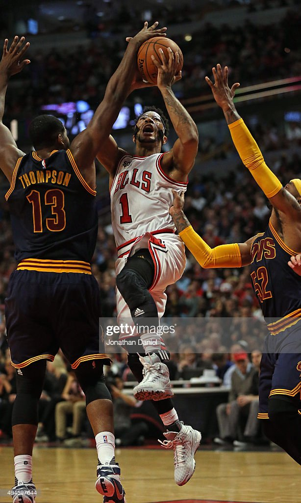 Derrick Rose #1 of the Chicago Bulls is fouled as he tries to drive between Tristan Thompson #13 and Mo Williams #52 of the Cleveland Cavaliers during the season opening game at the United Center on October 27, 2015 in Chicago, Illinois. The Bulls defeated the Cavaliers 97-95. Note to User: User expressly acknowledges and agrees that, by downloading and or using the photograph, User is consenting to the terms and conditions of the Getty Images License Agreement.