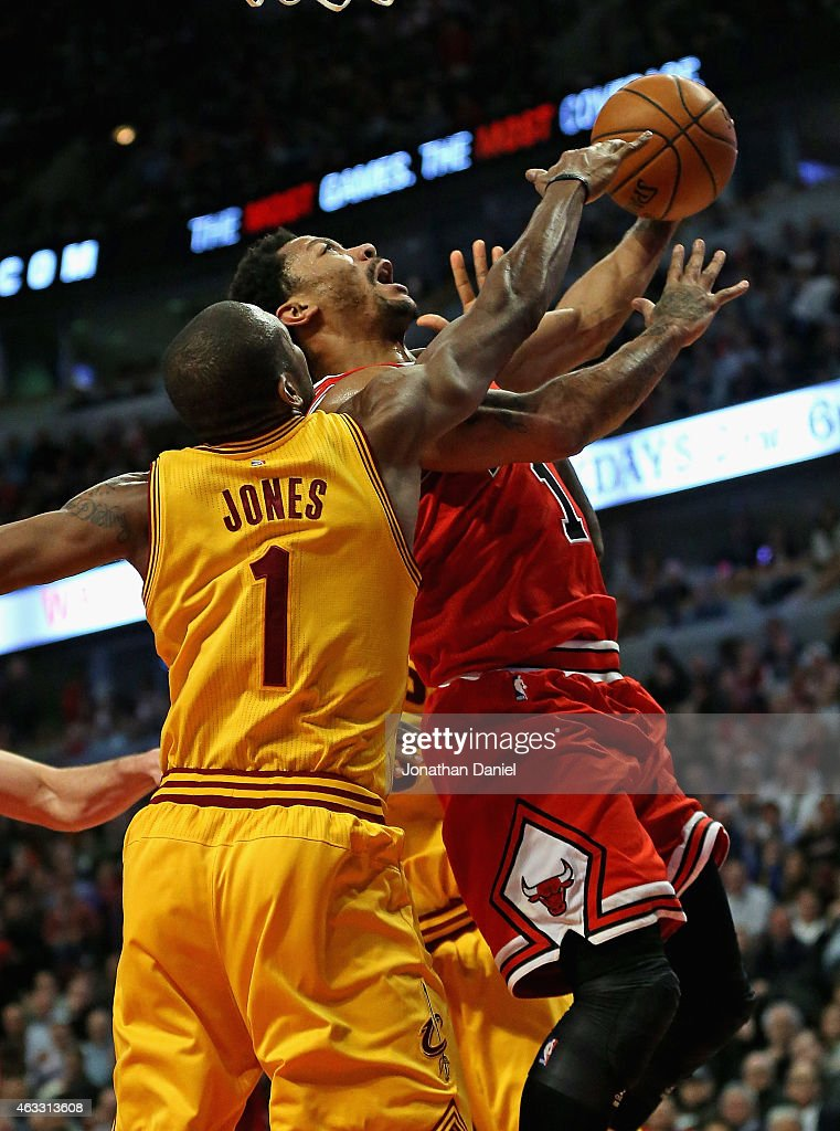 Derrick Rose #1 of the Chicago Bulls is fouled by James Jones #1 of the Cleveland Cavaliers at the United Center on February 12, 2015 in Chicago, Illinois. The Bulls defeated the Cavaliers 113-98.