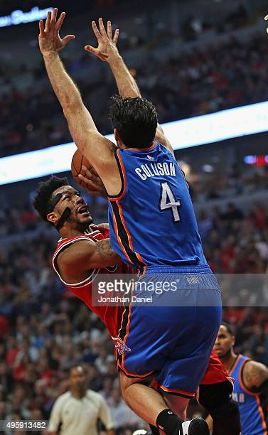 Derrick Rose of the Chicago Bulls is fouled by Nick Collison of the Oklahoma City Thunder at the United Center on November 5 2015 in Chicago Illinois...