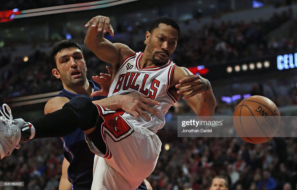 Derrick Rose of the Chicago Bulls is fouled by Zaza Pachulia of the Dallas Mavericks at the United Center on January 15 2016 in Chicago Illinois The...