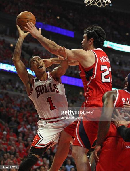Derrick Rose of the Chicago Bulls is fouled while shooting by Zaza Pachulia of the Atlanta Hawks in Game Five of the Eastern Conference Semifinals in...