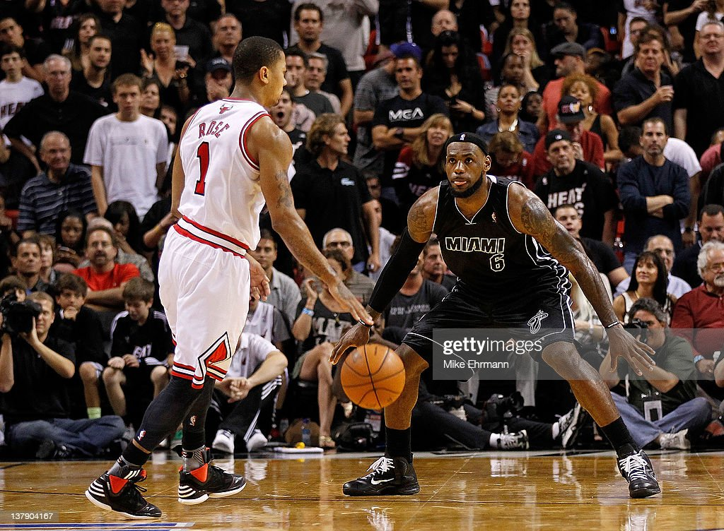 Derrick Rose #1 of the Chicago Bulls is guarded by LeBron James #6 of the Miami Heat during a game at American Airlines Arena on January 29, 2012 in Miami, Florida.