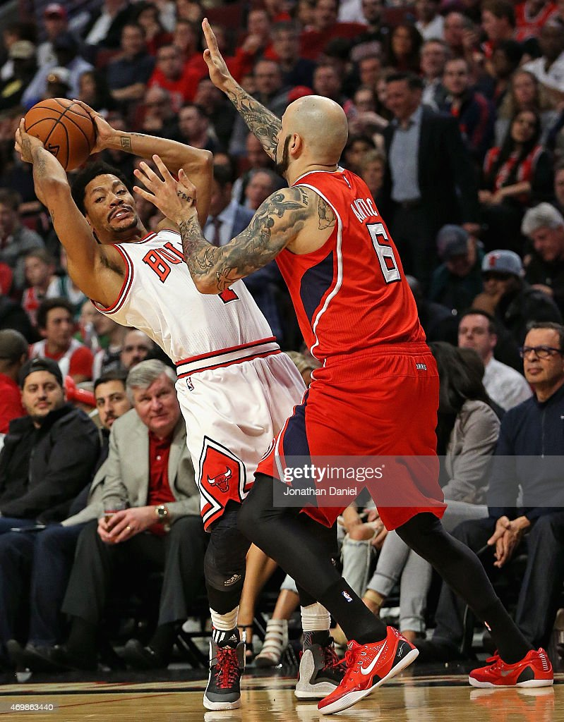 <a gi-track='captionPersonalityLinkClicked' href=/galleries/search?phrase=Derrick+Rose&family=editorial&specificpeople=4212732 ng-click='$event.stopPropagation()'>Derrick Rose</a> #1 of the Chicago Bulls is pressured by Pero Antic #6 of the Atlanta Hawks at the United Center on April 15, 2015 in Chicago, Illinois. The Bulls defeated the Hawks 91-85.