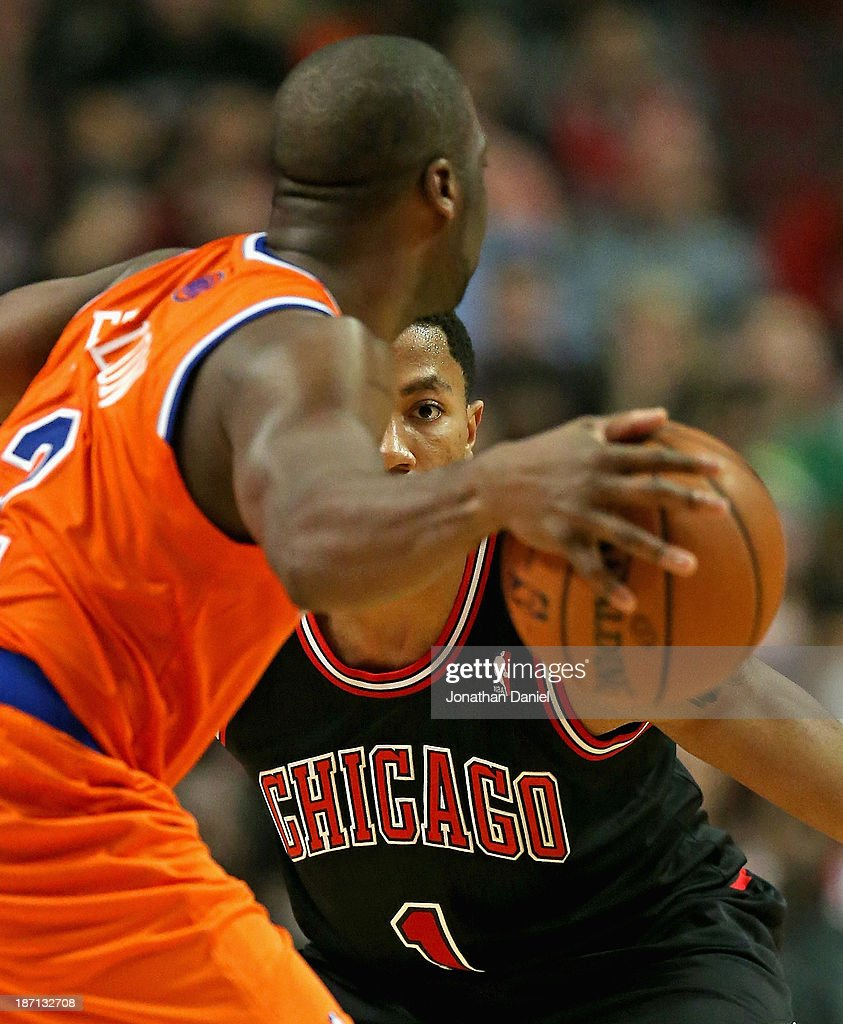 Derrick Rose #1 of the Chicago Bulls keeps an eye on Raymond Felton #2 of the New York Knicks at the United Center on October 31, 2013 in Chicago, Illinois. The Bulls defeated the Knicks 82-81.