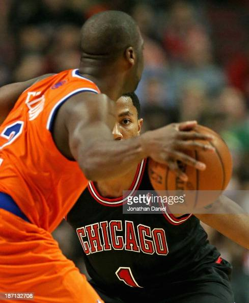Derrick Rose of the Chicago Bulls keeps an eye on Raymond Felton of the New York Knicks at the United Center on October 31 2013 in Chicago Illinois...