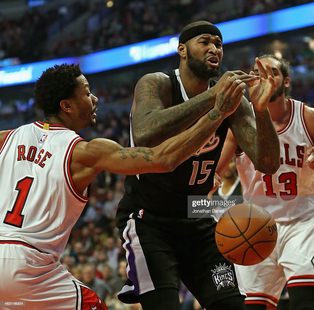 Derrick Rose of the Chicago Bulls knocks the ball away from DeMarcus Cousins of the Sacramento Kings at United Center on February 10 2015 in Chicago...