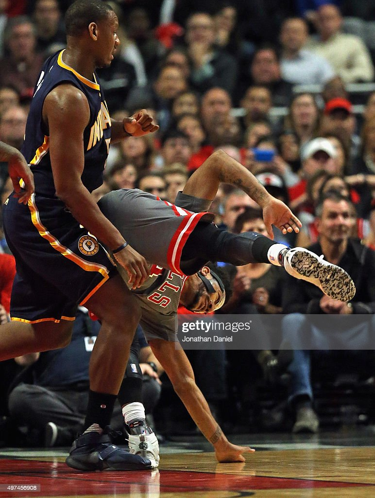 <a gi-track='captionPersonalityLinkClicked' href=/galleries/search?phrase=Derrick+Rose&family=editorial&specificpeople=4212732 ng-click='$event.stopPropagation()'>Derrick Rose</a> #1 of the Chicago Bulls lands akwardly as he is guard by <a gi-track='captionPersonalityLinkClicked' href=/galleries/search?phrase=Lavoy+Allen&family=editorial&specificpeople=4628334 ng-click='$event.stopPropagation()'>Lavoy Allen</a> #5 of the Indiana Pacers at the United Center on November 16, 2015 in Chicago, Illinois. The Bulls defeated the Pacers 96-95. Note to User: User expressly acknowledges and agrees that, by downloading and or using the photograph, User is consenting to the terms and conditions of the Getty Images License Agreement.