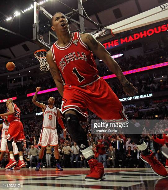 Derrick Rose of the Chicago Bulls lets out a scream after dunking the ball against the New York Knicks at the United Center on March 12 2012 in...