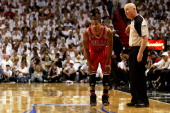 Derrick Rose of the Chicago Bulls looks on along with referee Joey Crawford against the Miami Heat in Game Four of the Eastern Conference Finals...