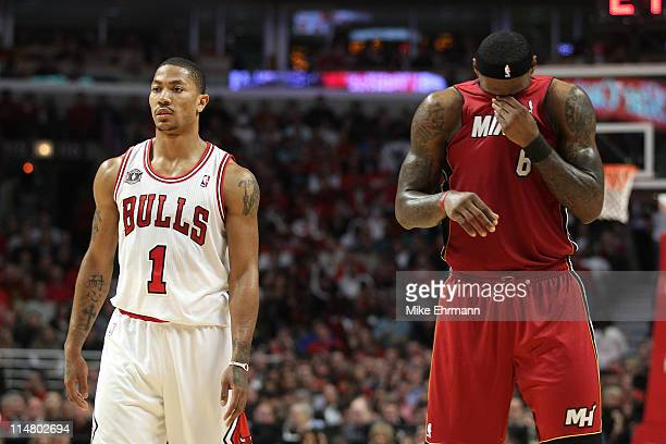 Derrick Rose of the Chicago Bulls looks on as LeBron James of the Miami Heat wipes his face with his jersey in Game Five of the Eastern Conference...