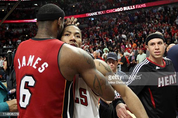 Derrick Rose of the Chicago Bulls looks on dejected as he congratulates LeBron James of the Miami Heat after the Heat won 8380 in Game Five of the...