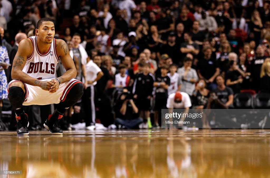 Derrick Rose #1 of the Chicago Bulls looks on during a game against the Miami Heat at American Airlines Arena on January 29, 2012 in Miami, Florida.