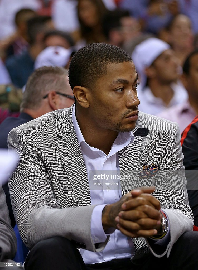 Derrick Rose #1 of the Chicago Bulls looks on during Game Five of the Eastern Conference Semifinals of the 2013 NBA Playoffs against the Miami Heat at American Airlines Arena on May 15, 2013 in Miami, Florida.