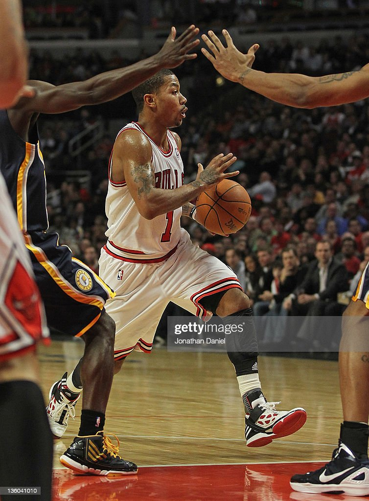 <a gi-track='captionPersonalityLinkClicked' href=/galleries/search?phrase=Derrick+Rose&family=editorial&specificpeople=4212732 ng-click='$event.stopPropagation()'>Derrick Rose</a> #1 of the Chicago Bulls looks to pass against the Indiana Pacers at the United Center on December 20, 2011 in Chicago, Illinois. The Bulls defeated the Pacers 93-85.