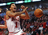 Derrick Rose of the Chicago Bulls looses control of the ball after it was knocked away by Michael CarterWilliams of the Milwaukee Bucks during the...