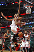 Derrick Rose of the Chicago Bulls looses control of the ball as he tries to shoot against John Henson of the Milwaukee Bucks during the first round...