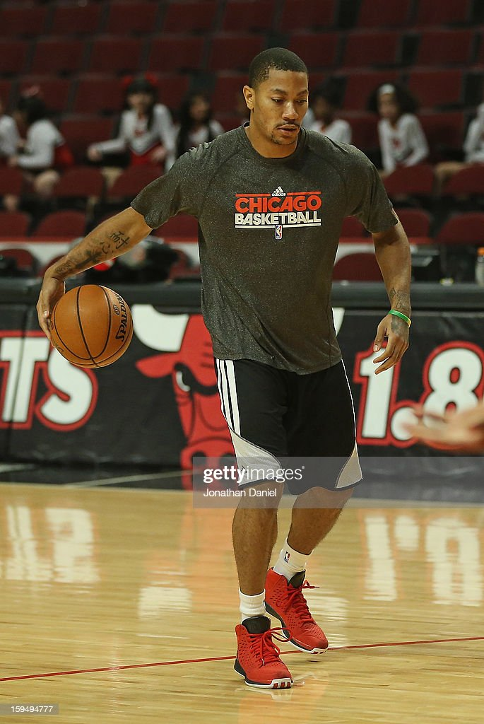 Derrick Rose #1 of the Chicago Bulls participates in a shoot-around before a game between the Bulls and the Phoenix Suns as he continues his rehab from knee surgery last May at the United Center on January 12, 2013 in Chicago, Illinois.
