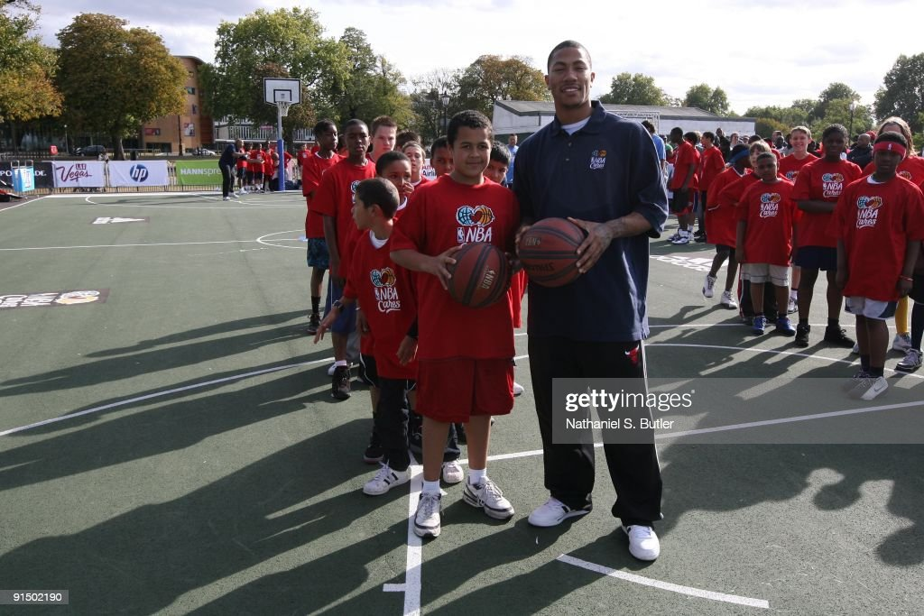 Derrick Rose of the Chicago Bulls poses with a kid at a NBA Cares Basketball Clinic during the 2009 NBA Europe Live on October 4 2009 at Clapham...
