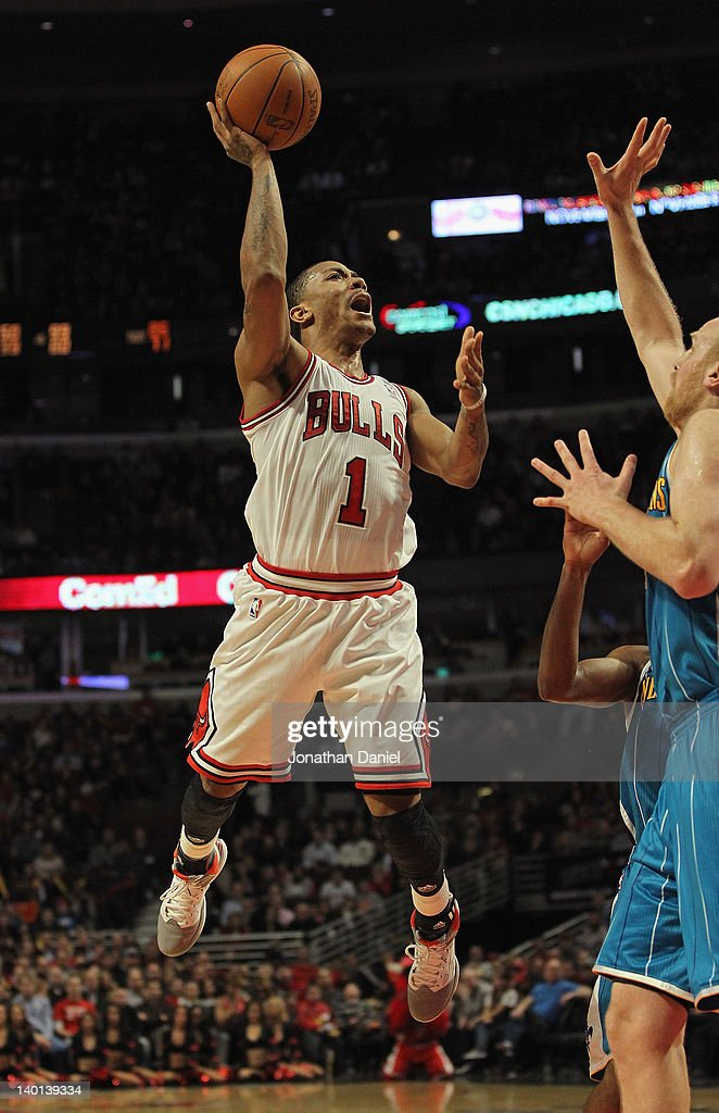 <a gi-track='captionPersonalityLinkClicked' href=/galleries/search?phrase=Derrick+Rose&family=editorial&specificpeople=4212732 ng-click='$event.stopPropagation()'>Derrick Rose</a> #1 of the Chicago Bulls puts up a shot against <a gi-track='captionPersonalityLinkClicked' href=/galleries/search?phrase=Chris+Kaman&family=editorial&specificpeople=201661 ng-click='$event.stopPropagation()'>Chris Kaman</a> #35 of the New Orleans Hornets on his way to a game-high 32 points at the United Center on February 28, 2012 in Chicago, Illinois. The Bulls defeated the Hornets 99-95.