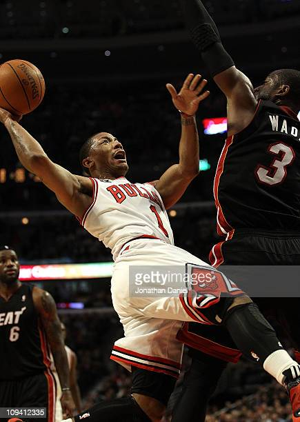 Derrick Rose of the Chicago Bulls puts up a shot against Dwyane Wade of the Miami Heat at the United Center on February 24 2011 in Chicago Illinois...