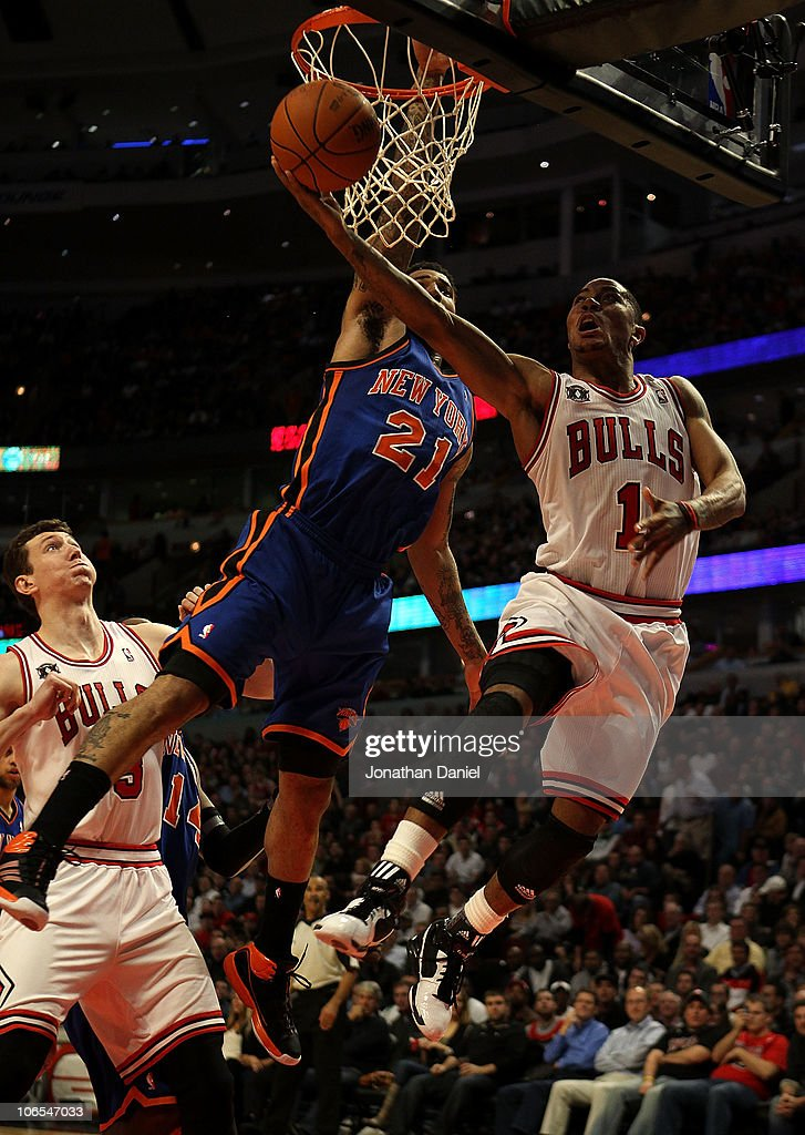 Derrick Rose of the Chicago Bulls puts up a shot against Wilson Chandler of the New York Knicks at the United Center on November 4 2010 in Chicago...