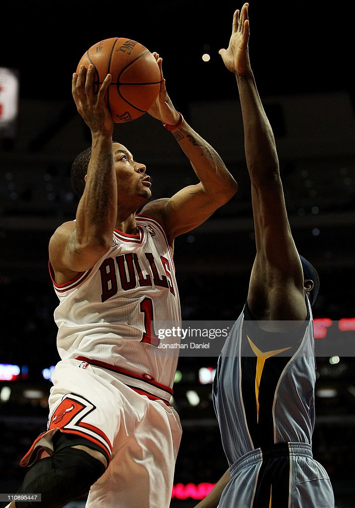 <a gi-track='captionPersonalityLinkClicked' href=/galleries/search?phrase=Derrick+Rose&family=editorial&specificpeople=4212732 ng-click='$event.stopPropagation()'>Derrick Rose</a> #1 of the Chicago Bulls puts up a shot against <a gi-track='captionPersonalityLinkClicked' href=/galleries/search?phrase=Zach+Randolph&family=editorial&specificpeople=201595 ng-click='$event.stopPropagation()'>Zach Randolph</a> #50 of the Memphis Girzzlies on his way to a game-high 24 points at the United Center on March 25, 2011 in Chicago, Illinois. Rose will donate $1,000.00 for every point he scored tonight to the Direct Relief Japan Relief and Recovery Fund. The Bulls defeated the Grizzlies 99-96.