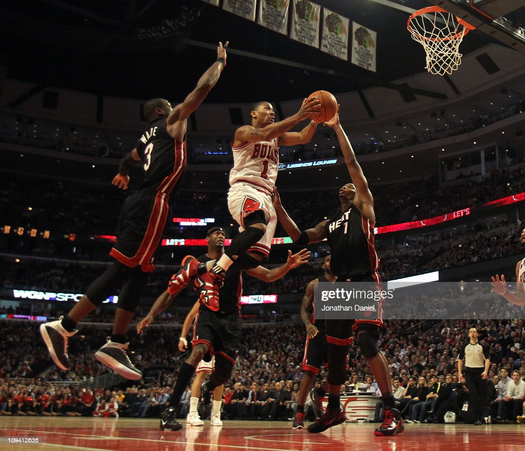 <a gi-track='captionPersonalityLinkClicked' href=/galleries/search?phrase=Derrick+Rose&family=editorial&specificpeople=4212732 ng-click='$event.stopPropagation()'>Derrick Rose</a> #1 of the Chicago Bulls puts up a shot between <a gi-track='captionPersonalityLinkClicked' href=/galleries/search?phrase=Dwyane+Wade&family=editorial&specificpeople=201481 ng-click='$event.stopPropagation()'>Dwyane Wade</a> #3 and <a gi-track='captionPersonalityLinkClicked' href=/galleries/search?phrase=Chris+Bosh&family=editorial&specificpeople=201574 ng-click='$event.stopPropagation()'>Chris Bosh</a> #1 of the Miami Heat at the United Center on February 24, 2011 in Chicago, Illinois. The Bulls defeated the Heat 93-89.