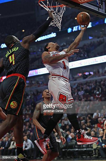 Derrick Rose of the Chicago Bulls puts up a shot between Paul Millsap and Jeff Teague of the Atlanta Hawks at the United Center on February 10 2016...