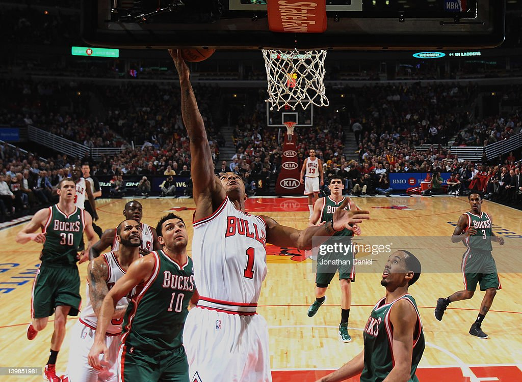 <a gi-track='captionPersonalityLinkClicked' href=/galleries/search?phrase=Derrick+Rose&family=editorial&specificpeople=4212732 ng-click='$event.stopPropagation()'>Derrick Rose</a> #1 of the Chicago Bulls puts up a shot over <a gi-track='captionPersonalityLinkClicked' href=/galleries/search?phrase=Carlos+Delfino&family=editorial&specificpeople=206625 ng-click='$event.stopPropagation()'>Carlos Delfino</a> #10 and <a gi-track='captionPersonalityLinkClicked' href=/galleries/search?phrase=Shaun+Livingston&family=editorial&specificpeople=202955 ng-click='$event.stopPropagation()'>Shaun Livingston</a> #9 of the Milwaukee Bucks at the United Center on February 22, 2012 in Chicago, Illinois. The Bulls defeated the Bucks 110-91.
