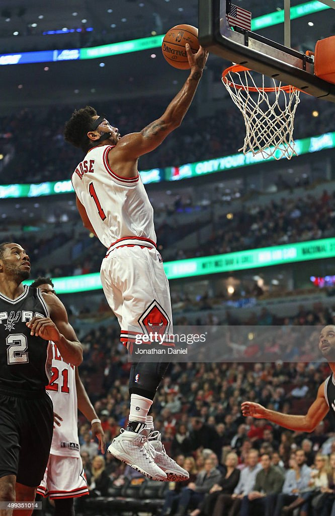 Derrick Rose #1 of the Chicago Bulls puts up a shot past Kawhi Leonard #2 of the San Antonio Spurs at the United Center on November 30, 2015 in Chicago, Illinois. Note to User: User expressly acknowledges and agrees that, by downloading and or using the photograph, User is consenting to the terms and conditions of the Getty Images License Agreement.