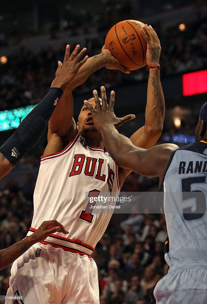 Derrick Rose #1 of the Chicago Bulls puts up a shot under pressure from Zach Randolph #50 of the Memphis Grizzlies at the United Center on March 25, 2011 in Chicago, Illinois. The Bulls defeated the Grizzlies 99-96.