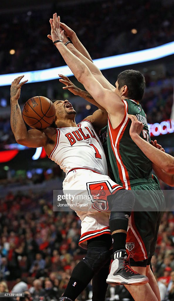 <a gi-track='captionPersonalityLinkClicked' href=/galleries/search?phrase=Derrick+Rose&family=editorial&specificpeople=4212732 ng-click='$event.stopPropagation()'>Derrick Rose</a> #1 of the Chicago Bulls runs into <a gi-track='captionPersonalityLinkClicked' href=/galleries/search?phrase=Ersan+Ilyasova&family=editorial&specificpeople=557070 ng-click='$event.stopPropagation()'>Ersan Ilyasova</a> #7 of the Milwaukee Bucks during the first round of the 2015 NBA Playoffs at the United Center on April 27, 2015 in Chicago, Illinois. The Bucks defeated the Bulls 94-88.