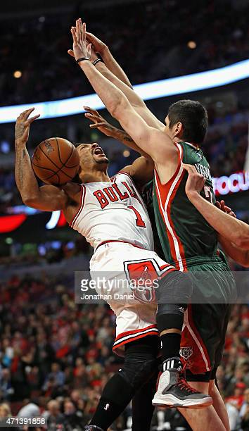 Derrick Rose of the Chicago Bulls runs into Ersan Ilyasova of the Milwaukee Bucks during the first round of the 2015 NBA Playoffs at the United...