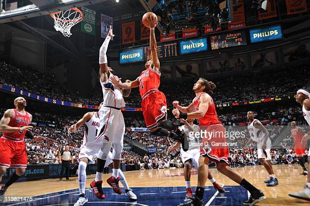 Derrick Rose of the Chicago Bulls shoots against Josh Smith of the Atlanta Hawks in Game Three of the Eastern Conference Semifinals in the 2011 NBA...