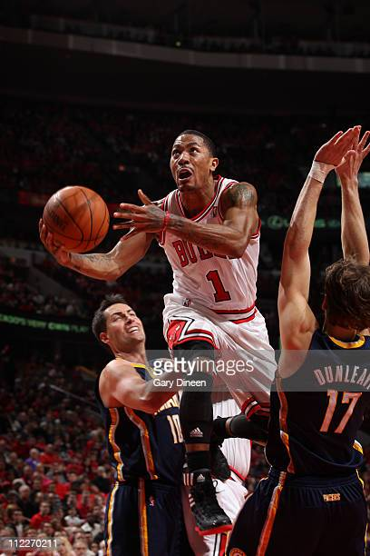 Derrick Rose of the Chicago Bulls shoots against Mike Dunleavy of the Indiana Pacers in Game One of the Eastern Conference Quarterfinals in the 2011...