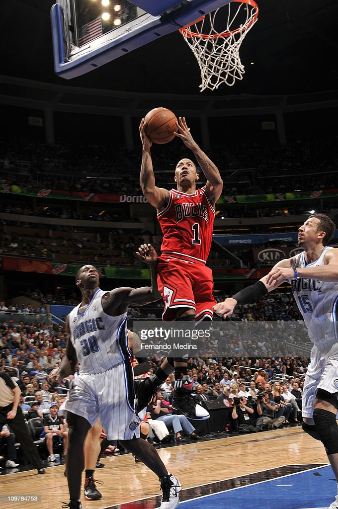 <a gi-track='captionPersonalityLinkClicked' href=/galleries/search?phrase=Derrick+Rose&family=editorial&specificpeople=4212732 ng-click='$event.stopPropagation()'>Derrick Rose</a> #1 of the Chicago Bulls shoots over <a gi-track='captionPersonalityLinkClicked' href=/galleries/search?phrase=Brandon+Bass&family=editorial&specificpeople=233806 ng-click='$event.stopPropagation()'>Brandon Bass</a> #30 and <a gi-track='captionPersonalityLinkClicked' href=/galleries/search?phrase=Hedo+Turkoglu&family=editorial&specificpeople=201639 ng-click='$event.stopPropagation()'>Hedo Turkoglu</a> #15 of the Orlando Magic on March 4, 2011 at the Amway Center in Orlando, Florida.